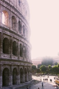 Vertical shot of the great Roman Coliseum on a sunny day