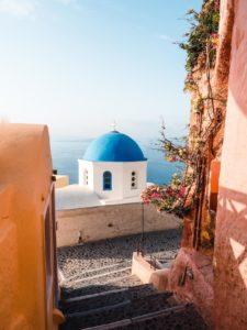 Vertical shot of a blue dome at Santorini, Greece
